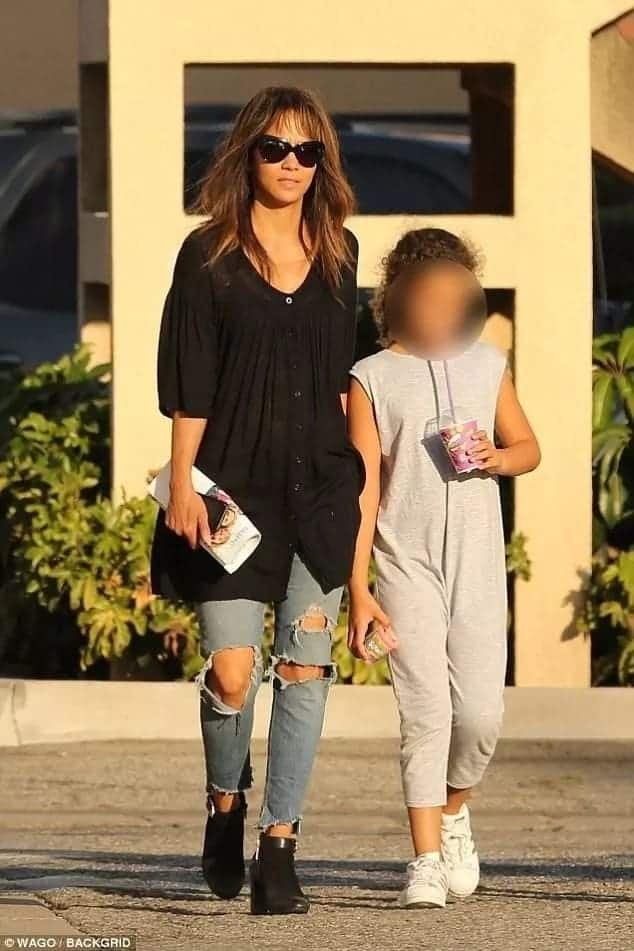 Actress Halle Berry cuts a casual figure in ripped jeans as she spends some quality time with daughter Nahla