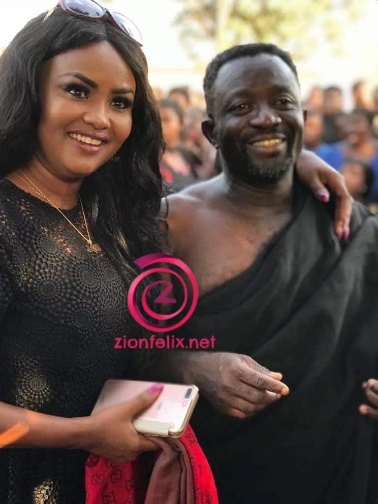 Nana Ama Mcbrown and Samuel Nyamekye clad in funeral clothing and smile for a photo