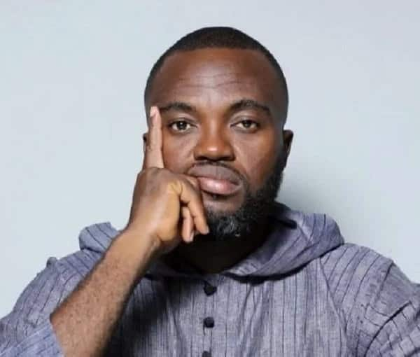 Ghanaian actor, Fred Nuamah puts a finger to his face