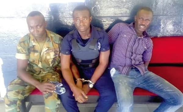 Military officer, policeman, arrested for allegedly robbing bank customers