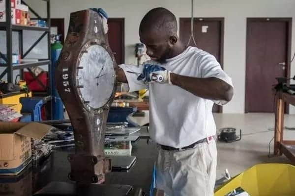 Meet the young man turning e-waste from Ghana's toxic dump into an art