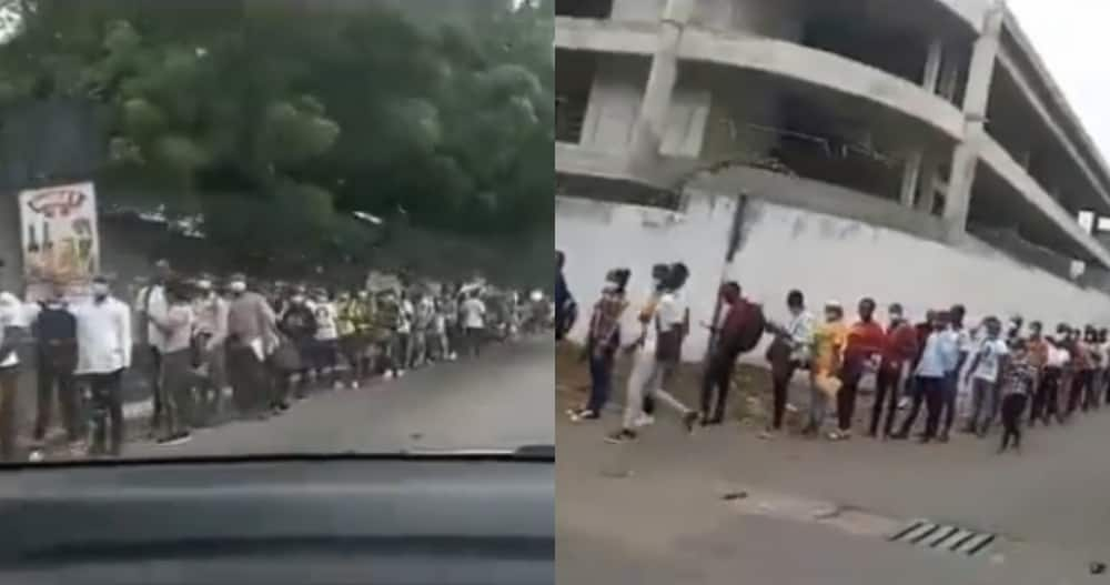 Man Screams in Video as Moving car is Unable to see the end of long Queue of Military Applicants