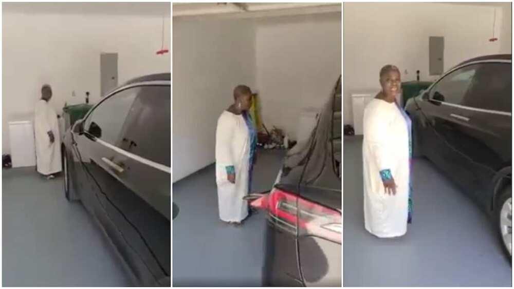 Nigerian woman surprised at seeing Tesla Car