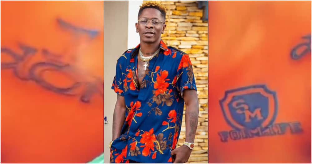 True love: Diehard fan tattoos 1 Don and For Life on her body to honour Shatta Wale in video
