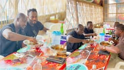 Photos of Stephen Appiah and Michael Essien eating TZ at 'chop bar' go viral