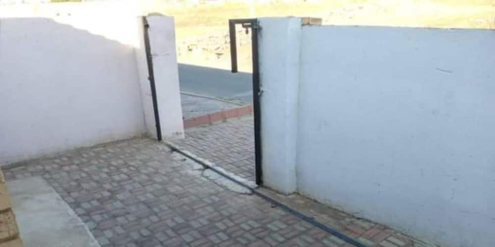 Social media reacts as lady says her house gate was stolen overnight