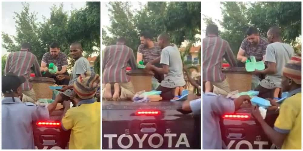 Nigerian White Man Feeds 150 People From the Top of a Car, Video Goes Viral, Sparks Huge Reactions