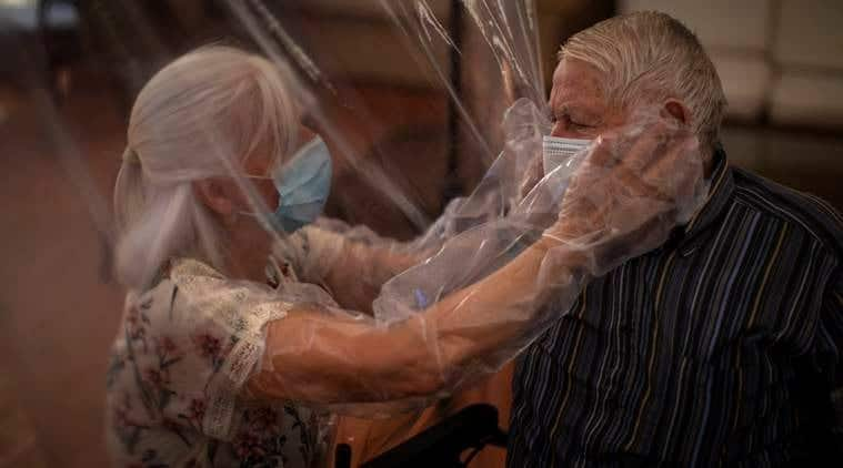 Heartwarming moment as elderly couple is allowed to hug through plastic screens