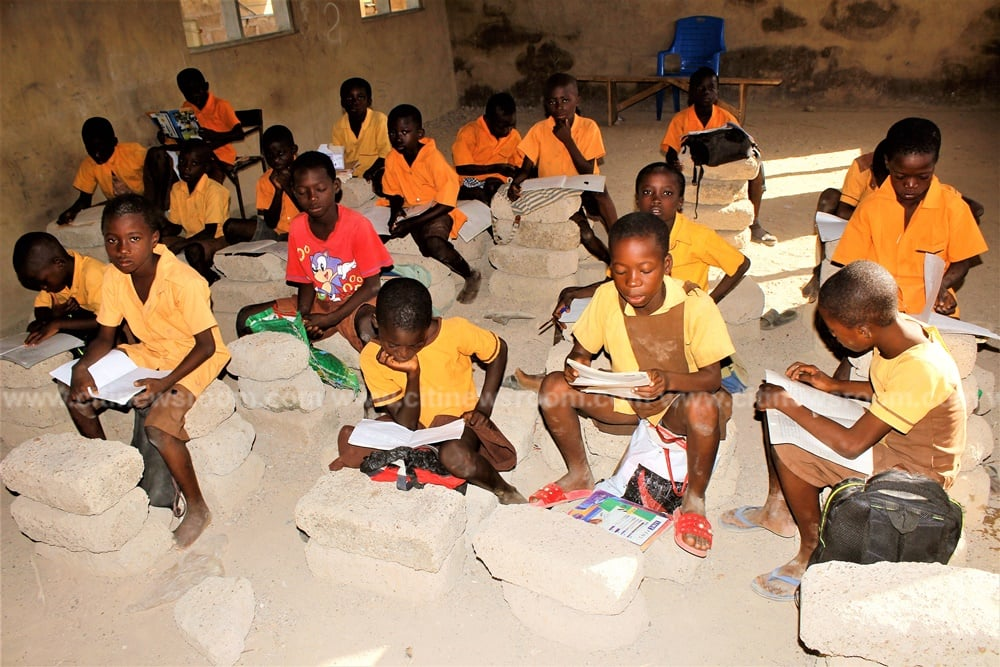 Pupils of Abolato primary use cement blocks to study