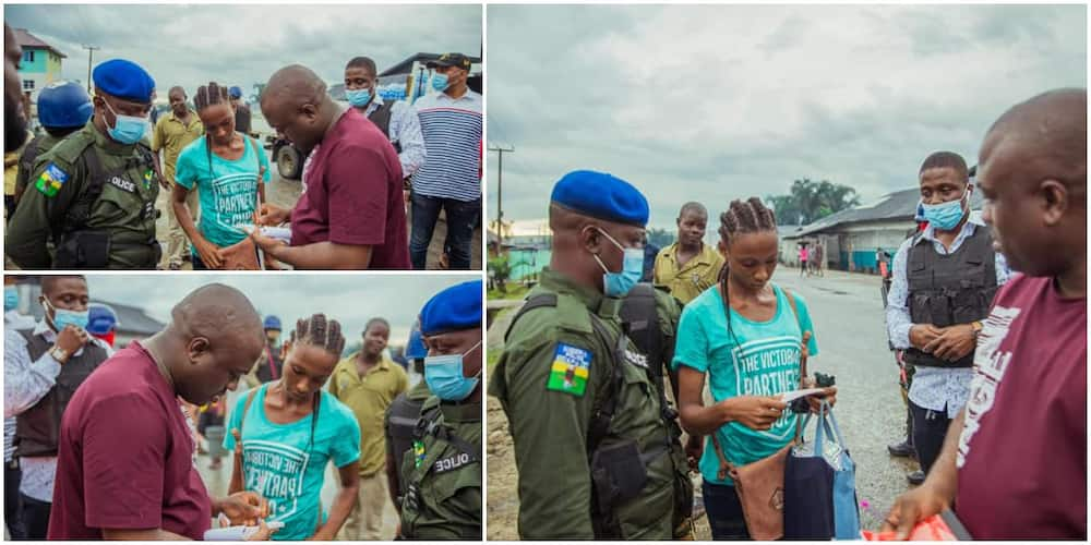 Reactions as Nigerian man surprises lady N500k for her calmness after his car mistakenly splashed water on her