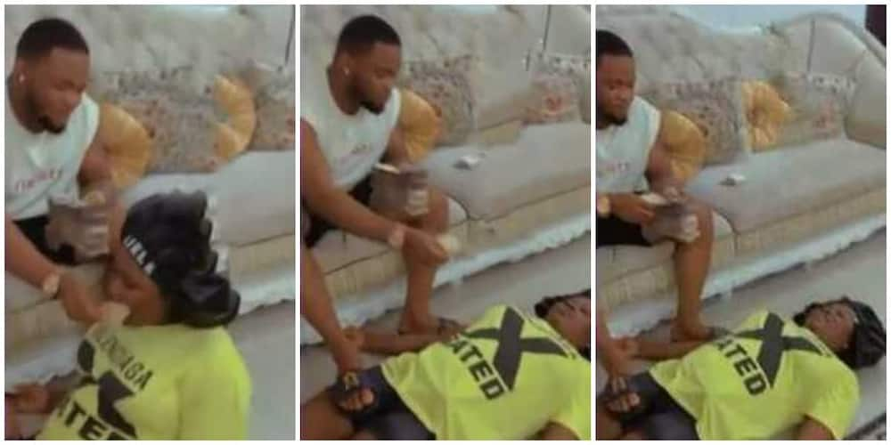 Reactions as Nigerian man motivates wife using money, video causes sitr