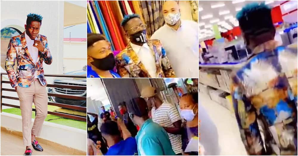 Shatta Wale mobbed by fans as he goes shopping in new video