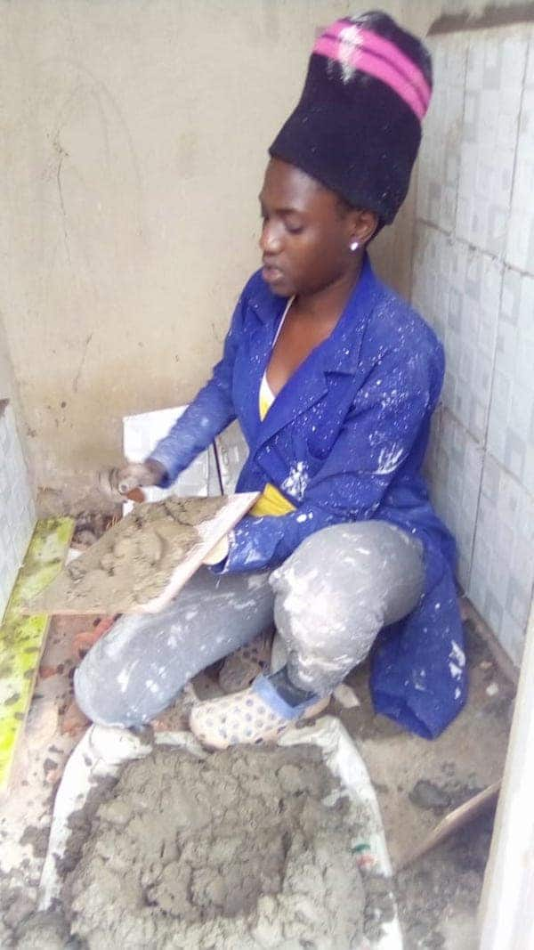 Female engineer warms hearts online after tiling public toilets for free