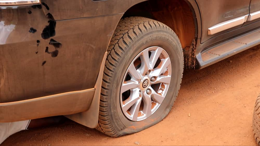 Bad roads at Sissala causes flat tire of Roads and Highways Minister's Land Cruiser