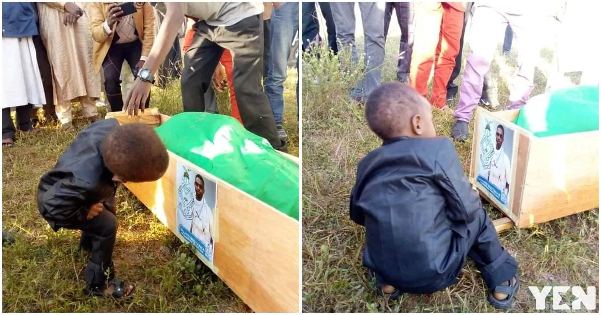 Photo of little Nigerian boy staring at his late father's photo during burial goes viral