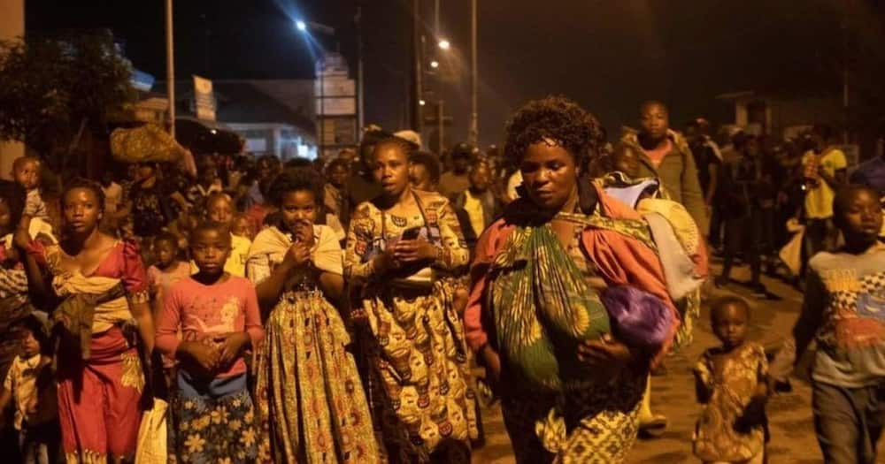 Thousands of panic-stricken residents carrying mattresses and other belongings fled the city. Photo: Getty Images.