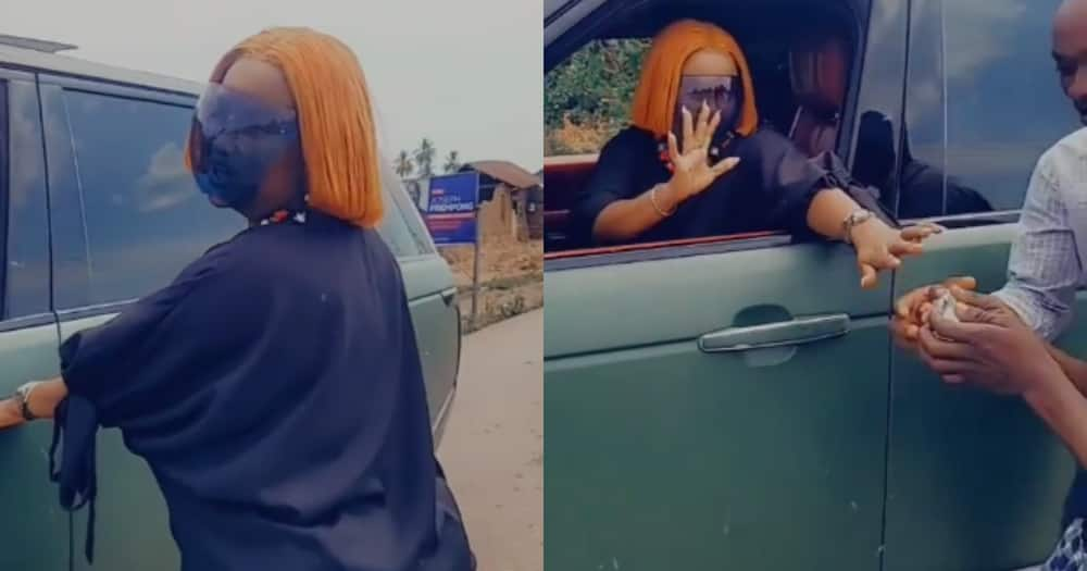 Nana Ama McBrown cruises in town in Range Rover, shows fans love as she gifts them money