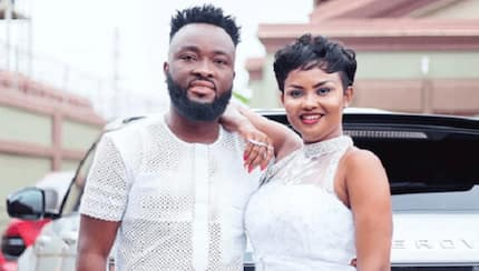 Wild video drops as Nana Ama McBrown and husband share hot kiss in a plane