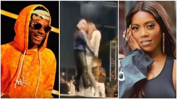 Tiwa Savage playfully slaps Wizkid's as he draws her closely by the waist (video)