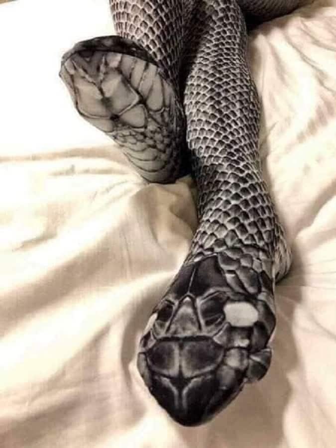 A photo of a leg coated with snakeskin