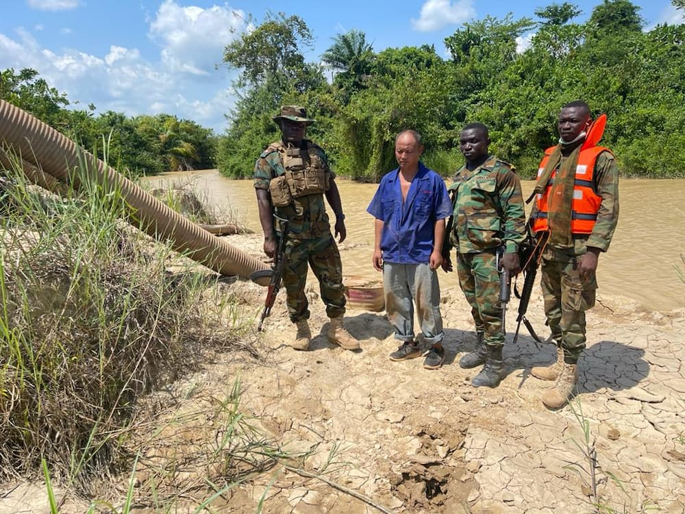 See what you have done to our river, can you drink this? - Military queries illegal Chinese gold miner