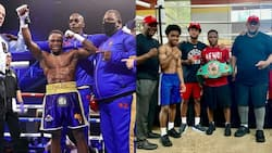 Isaac Dogboe receives NABF belt in his gym in Washington DC; photo drops