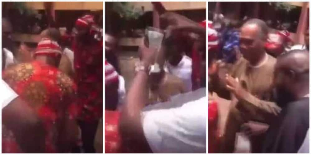 Reactions as FUTO graduates corner their lecturer, dance and spray him cash in cute video