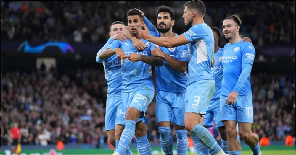 Joao Cancelo celebrates with teammates after scoring their side's fifth goal during the UEFA Champions League group A match against Leipzig (Photo by Matt McNulty - Manchester City/Manchester City FC via Getty Images)