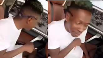 Shatta Wale spotted smoking and having fun in town after bail; speaks in video