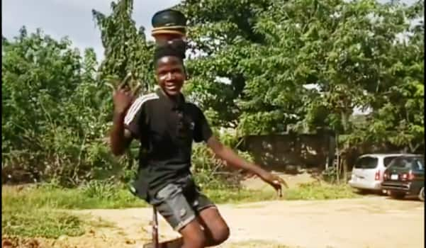 Young African boy wows everyone with amazing balancing act (Video)