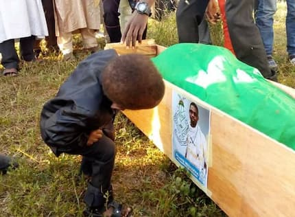 Little boy spotted staring at his late father's photo on his coffin causes grief