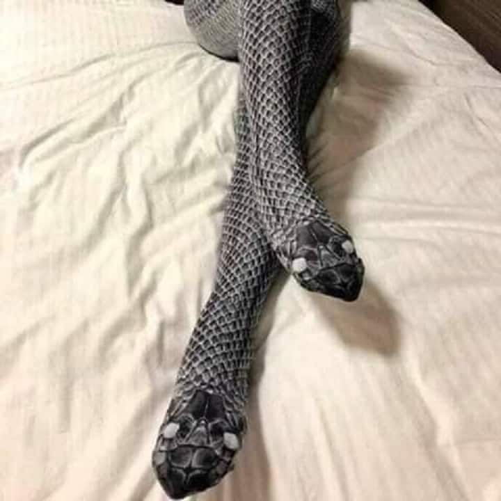 A woman's leg dressed in snake's costume