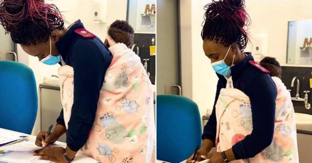 Local nurse holds baby while mom gets treated, photos go viral