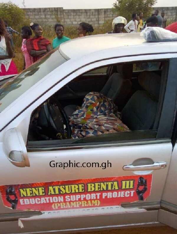 A man lying in a car