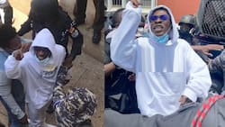 Video shows how an angry and swearing Shatta Wale was bundled in a police van to begin remand