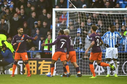 Man City hammer Huddersfield Town to close Liverpool's lead at the top of the EPL log