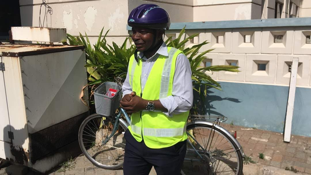 NDC MP storms Parliament on bicycle