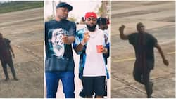 """""""My oga get money"""" - Video of Davido's boy running around airport with bell in his hand stirs reactions"""