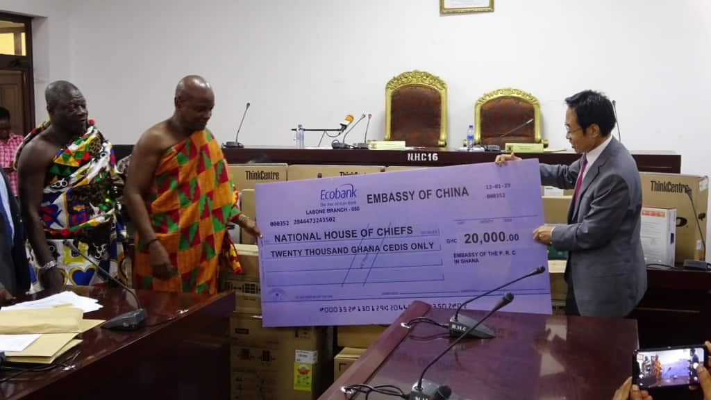 A man holding an enlarged cheque