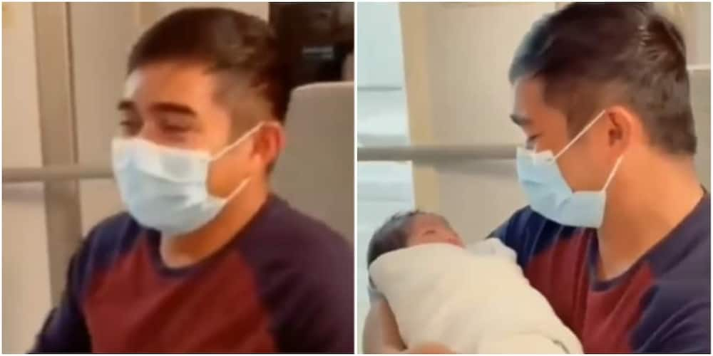 The father was emotional as he carried his baby for the first time