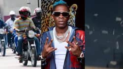 No Be Juju: Shatta Wale shows okada riders street love as he sprays cash on them in video