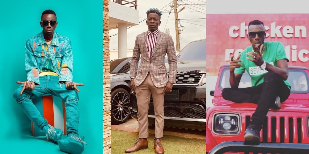 Joint 77 and Shatta Wale posing in front of their cars