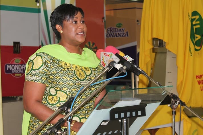 A woman standing behind a podium