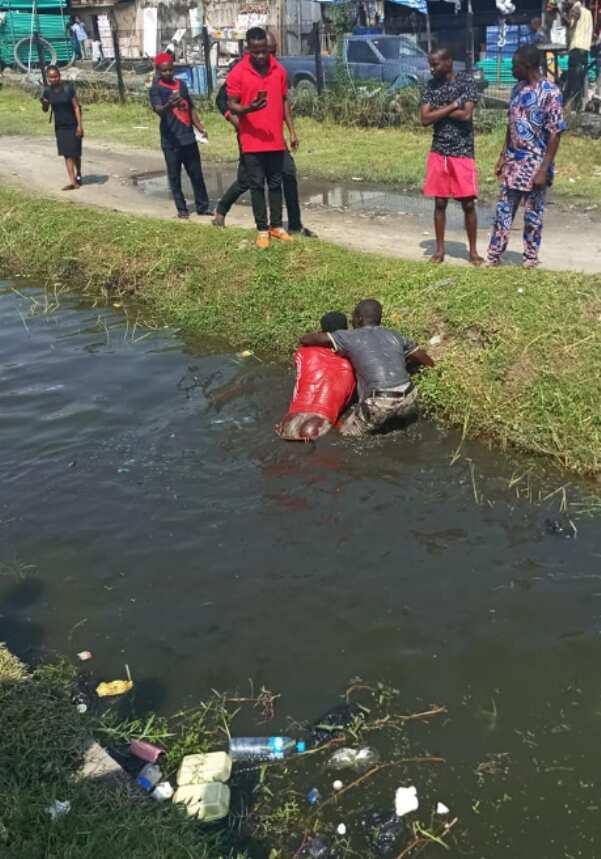 Two men in a gutter