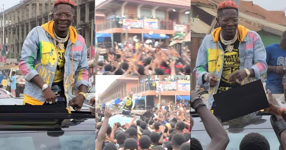 Shatta Wale sprays cash on 'Kumerican' fans as he gets mobbed in Kumasi