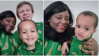 Black lady, white hubby and son storm England birthday party in African wears