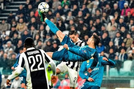 Cristiano Ronaldo son performs his own version of dad's stunning overhead kick