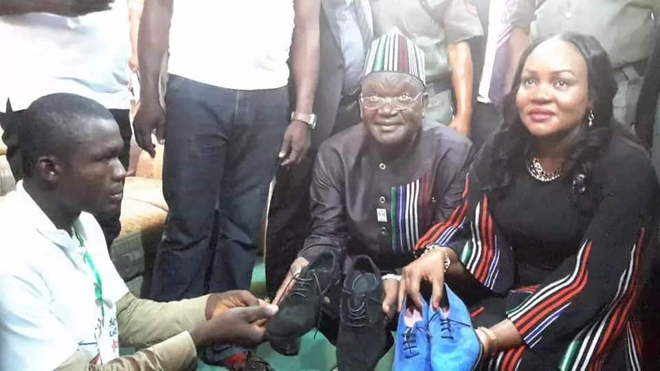 Crippled man makes shoes in Nigeria to earn a living (photos)